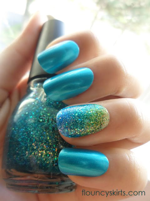 Mermaid Nails. The blue is Orly - It's Up to Blue. The glitter shades are all by Sinful Colors.