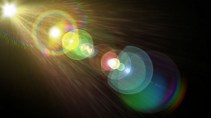 "Lens flare effect on black, created with ""Creation Lens Flares"" for After Effects."