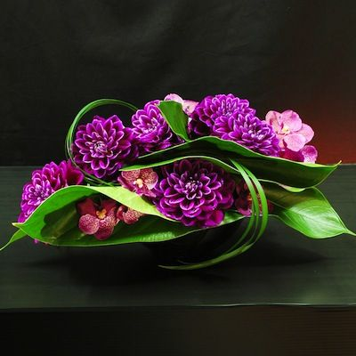 Flower arrangement from Kflorist. Note the beautiful shades of purple and shapes/layering of the leaf