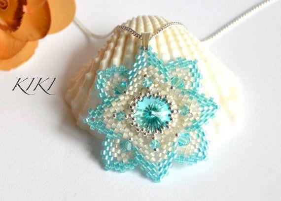 Pendant, peyote beaded star pendant with bezeled turquoise swarovski rivoli crystal and swarovski bicones