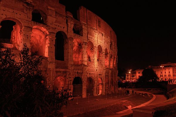 George Westermak Photograph - Night Lights Of The Colosseum -business Cards In Rome. by George Westermak#GeorgeWestermakFineArtPhotography #ArtForHome #FineArtPrints #travel #Italy