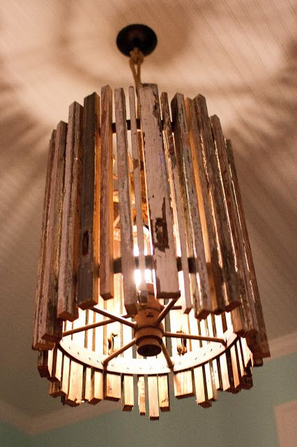 handmade light fixture - again, could use rulers and/or yardsticks w/ stain and color.