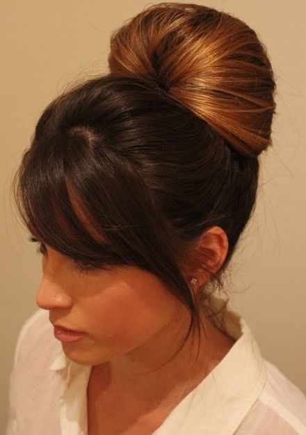 This pinned updo looks great with sideswept bangs