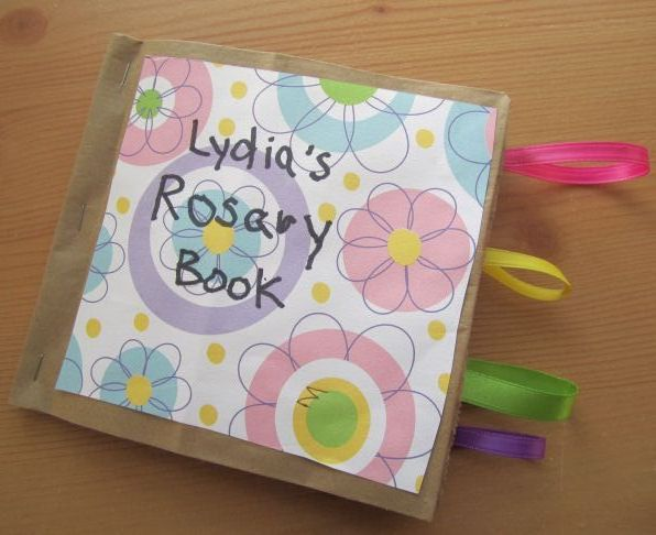 Catholic Craft for Kids- Make a Rosary Book! This is a paper bag book and has slide out pages for each set of mysteries. Very fun to make!