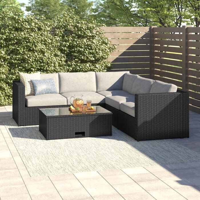 Cotswald 4 Piece Rattan Sectional Seating Group With Cushions Backyard Furniture Resin Patio Furniture Seating Groups