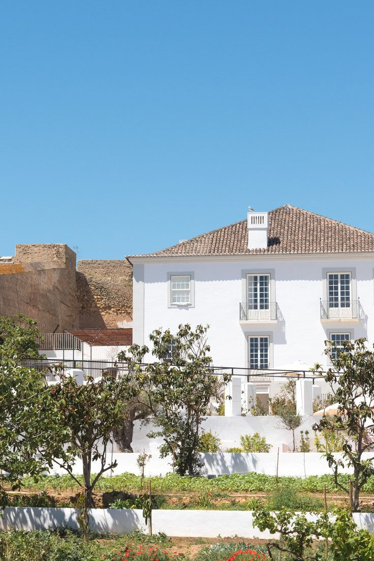 Where to Stay in Portugal: Our 10 Favorite Hotels  - It seems like almost everyone is going to Portugal this summer (at least according to FB and Insta). And can we blame them? There's the rich history, glorious beaches, world-class restaurants, vibrant cultural scene, and rolling vineyards to rival France and Spain. From Lisbon to the Algarve, these 10 hotels provide the perfect springboards for exploring the country's best.