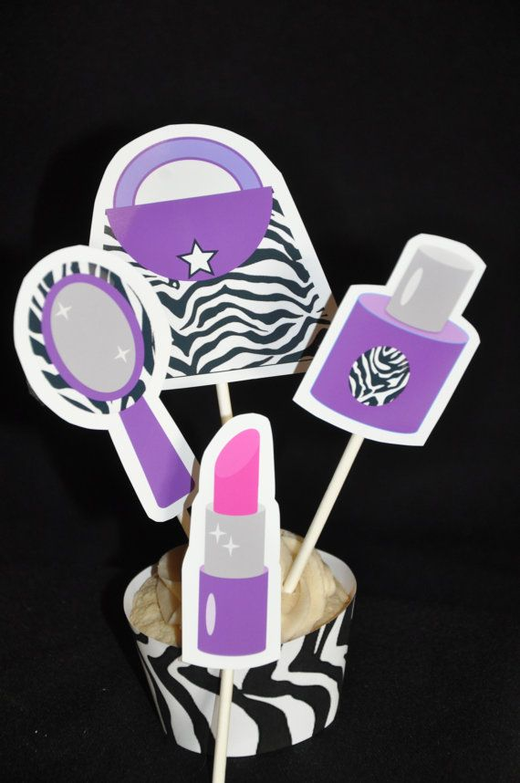 These funky zebra print cupcake toppers feature a purse, mirror, nail polish and lipstick.    They would be perfect for a makeup party, makeover party or spa party.    They are available in a purple design as well as hot pink.