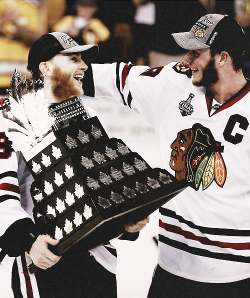 Patrick Kane and Jonathan Toews with the Conn Smythe Kane won as MVP for the 2013 playoffs.