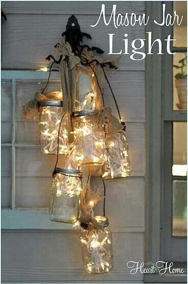 DIY Mason Jars and candles. Perfect to hang outside by my kitchen door just under our antique bell.