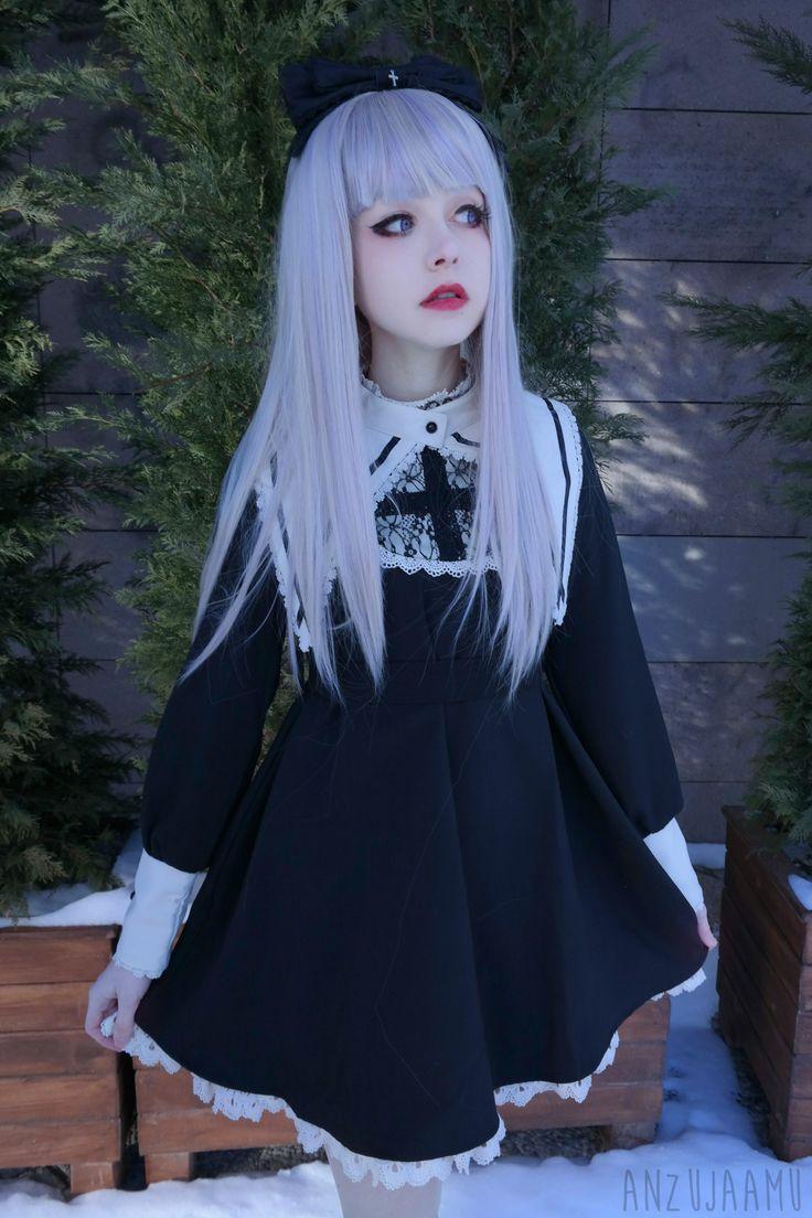 nu goth. she's extremely doll like, almost gothloli/gothic lolita, ...