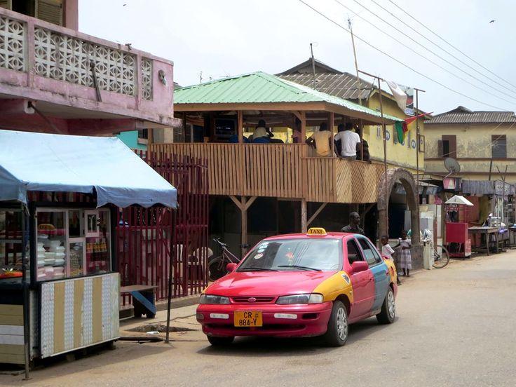 A colorfully-painted taxi awaits passengers at Elmina, Ghana.