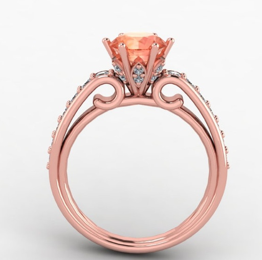 Voor wie wel van iets ongewoons houdt... Een roze gouden verlovingsring met een cognackleurige diamant.