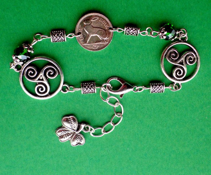 Harp and Shamrock with Emerald Crystals and Celtic knot Charms combine to make up this Irish Gift Bracelet. by VintageIrishDresser on Etsy