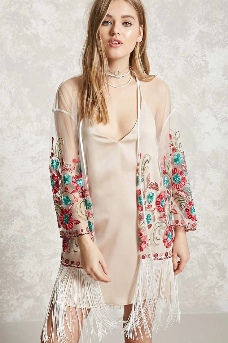 A sheer mesh kimono featuring floral embroidery, a fringed hem, scalloped edges, and an open front.