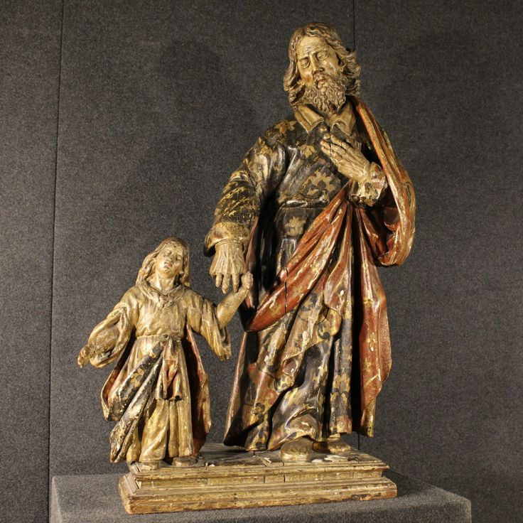 "Price: 7000€ French 18th century wooden sculpture. Work composed of two wooden sculptures with pedestal depicting ""St. Joseph and Jesus."" Sculptures made by carved lacquered and painted wood. Lacquering realized during the 19th century, the sculpture in fact has some traces of the original gilding. It has several signs of aging and small lacks in the hands. In good state of conservation, despite the age. #antiques #antiquariato Visit our website www.parino.it"