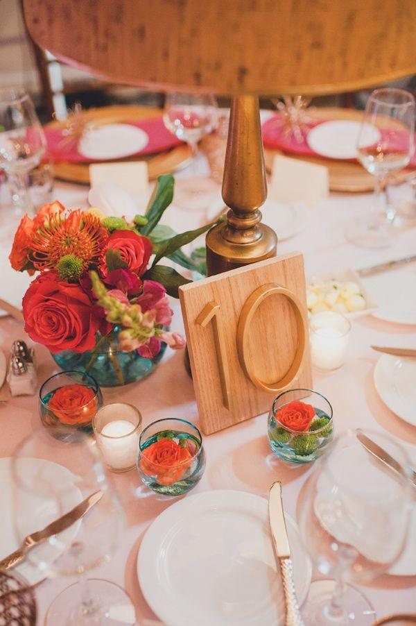 gold table number - photo by Carina Skrobecki http://ruffledblog.com/seattle-mid-century-modern-wedding
