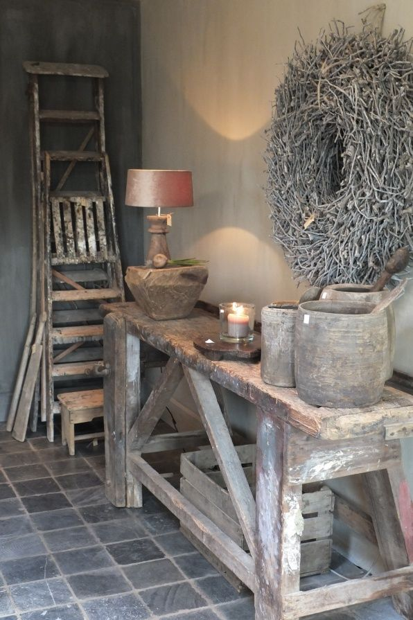 Rustic ladder leaning against side wall