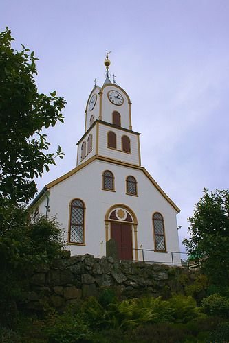 This small but picturesque cathedral in the center of Tórshavn was first established in the late 18th century, and has been the seat of the bishop of the Faroes since 1990. Still functioning as a place of worship for local residents, it's an atmospheric place to visit, with many old tombstones to explore and an attractive interior featuring wooden pews and decorative boats dangling from the ceiling. Located in Torshavn, Faroe Islands, Denmark