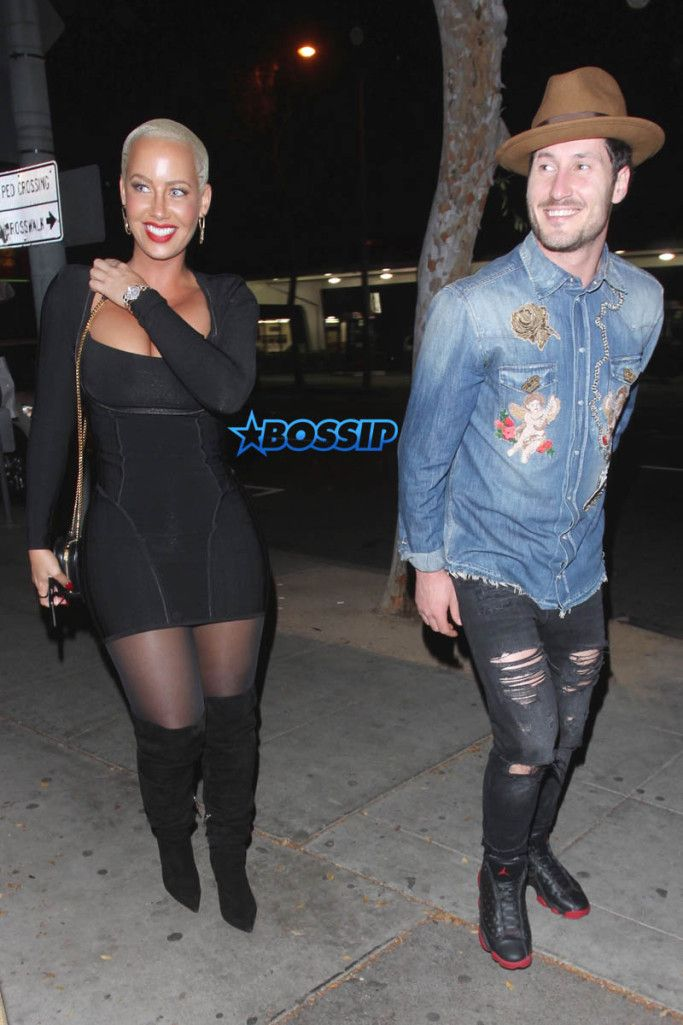 """Coupledom Confirmed? Amber Rose Poses With Her 'Heart' Val Chmerkovskiy  Amber Rose Confirms Relationship With Val Chmerkovskiy?        New couple alert???    Remember when we told you that  Amber Rose and her """"Dancing With The Stars"""" pal Val Chmerkovskiy  were playing coy about rumors that they're dating?   """"I can't control what people think,"""" Val previously told  Entertainment Tonight . """"I live my life and I try to live it, you know, the way I want to live it.""""   Well it looks like.."""