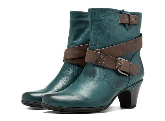 Buckle yourself in and enjoy the ride. It's hard not to in the Cobb Hill Sienna, a feminine ankle boot that gives a sleek nod to motorcycle styling. The wraparound strap is punctuated by an antiqued buckle and metal rivets – but it's the seemly heel height, convenient side zipper and adjustable ankle shaft that are guaranteed to get your engine revving.