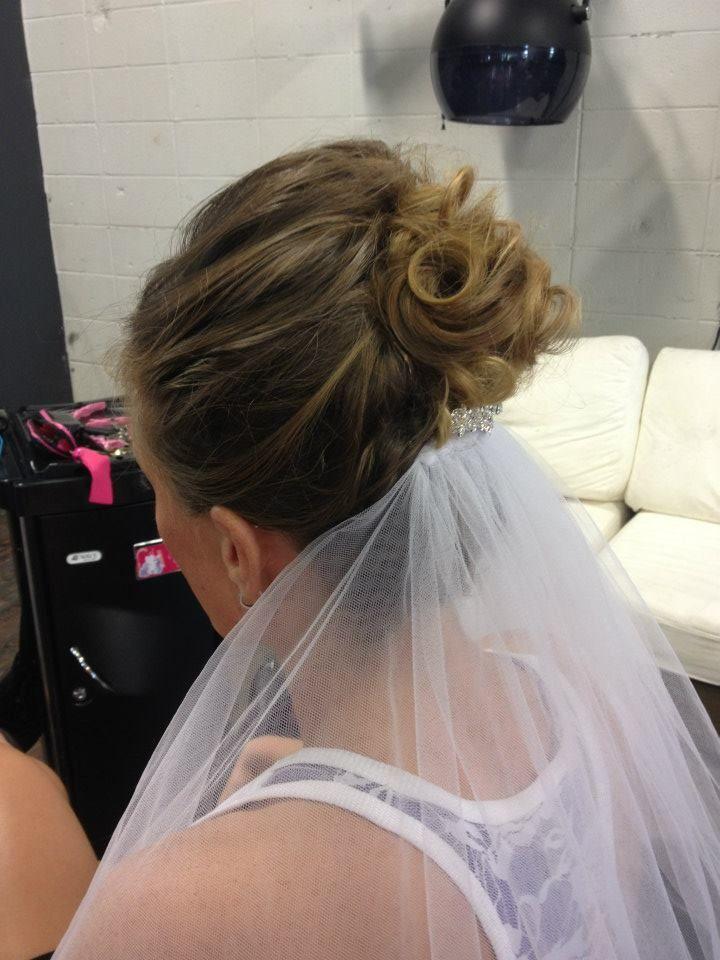 Wedding hair updo with curls by Manda