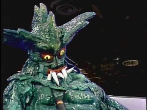 """Another of my all-time favorite sketches from SCTV is, """"The Tim Ishimuni Show"""". It was only done this one time, but it is a classic. John Candy's portrayal of """"Grogan"""" who is a Godzilla type Japanese monster, is just brilliant in his deadpan and laid-back essence as a radioactive creature. And Dave Thomas' """"Grogan. If you were to crush me, how would you crush me?"""" is comedy gold. You must watch this. You will understand my sense of humor a little better after viewing! Brilliant stuff!"""
