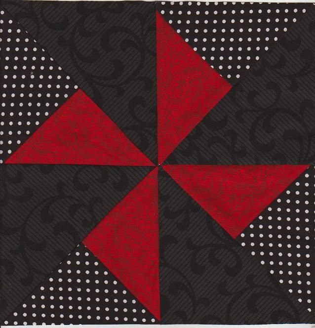 Pinwheel Quilt Bloc ... big squares ... luv the arrangement of black and red pieces ...
