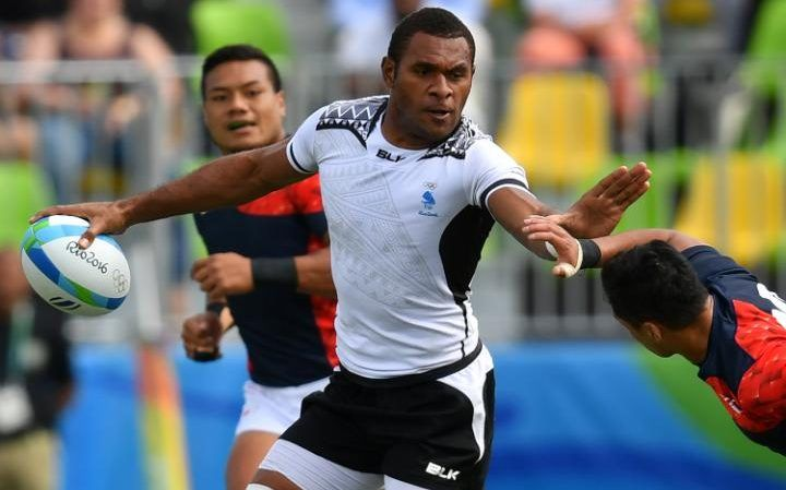 Fiji's Jasa Veremalua runs with the ball in the mens rugby sevens semi-final…