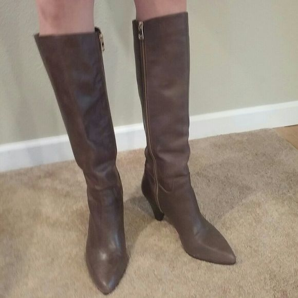 Michael Kors Tall Brown boots size 7-7.5 Michael Kors Greenwich Tall brown Boots. Leather upper with a rubber sole approx 3 inch heel. Fits closer to 7.5 marked 7. Preloved with some wear but still in good condition.Has more wear on left boot than right. Michael Kors Shoes Heeled Boots