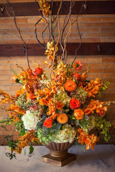 Stunning Centerpiece in Autumn tones    This glowing arrangement in a palette of orange, gold, ochre, tangerine, faded grey greens and white brightens any Fall celebration table. Lovely for a wedding, Thanksgiving table.