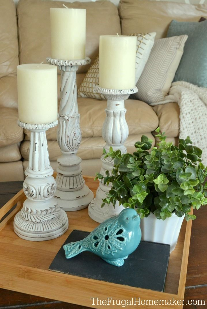 These outdated candle sticks got a much-needed facelift with white spray paint and wood stain paint.  Get the tutorial at The Frugal Homemaker.