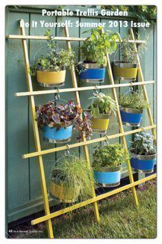 DIY hanging Garden idea using a trellis. Idea for the apartment balcony and an apartment garden. FYI: slide 'S' hooks on before gluing/nailing trellis.