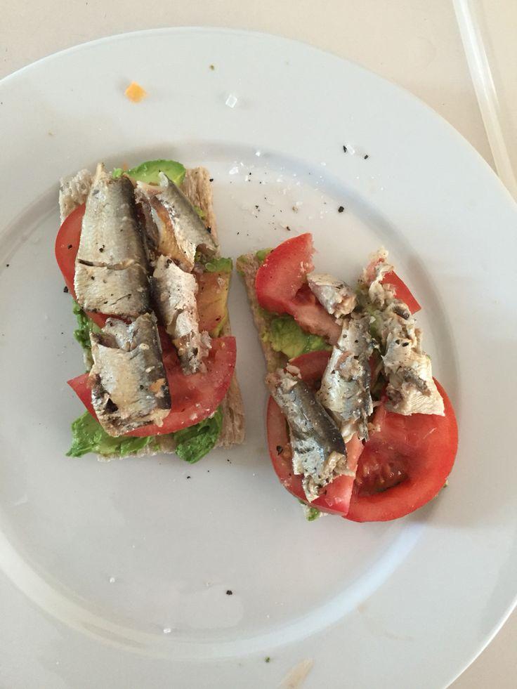 Sardine, tomato, avocado on crackers