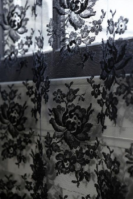 sugar paste black lace onto cellar window                              …