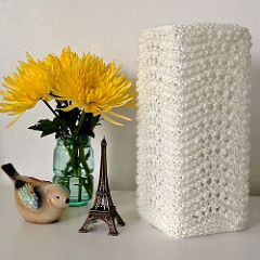 Pretty knit lamp covers made to fit IKEA Glas Bord lamps. Simple squared off shape highlights the rippling effect of the stitch pattern. Softens the glow and adds warmth and texture to plain glass shades.