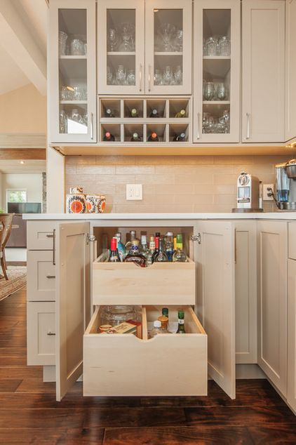 Secret Drawers: This is a cool design because it is something that you rarely see in the kitchen.  When you open the cabinet, you will usually see shelves but not in this case.