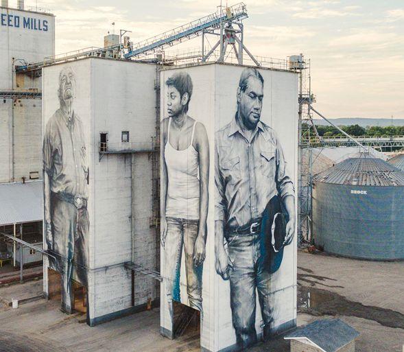 grain elevators painted by photorealistic artist Guido van Helten, in Fort Smith, Arkansas, USA. guidovanhelten.com