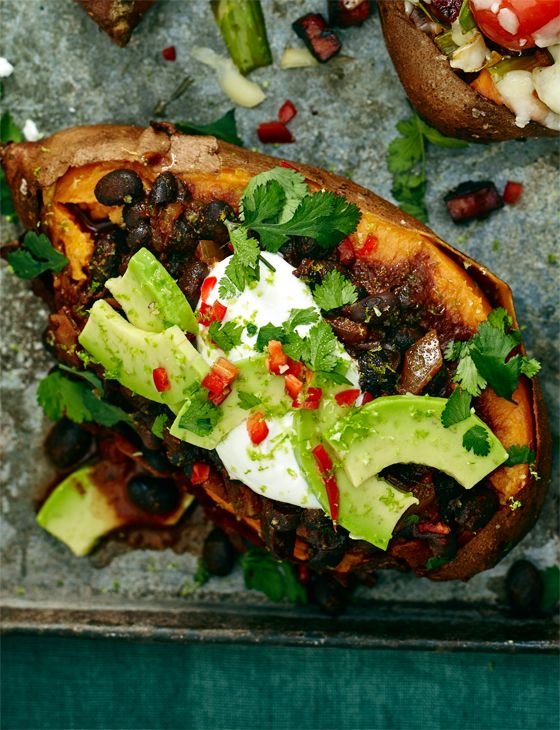 Baked sweet potato, creamy black bean chilli and avocado make a deliciously indulgent supper, perfect for those cold nights.