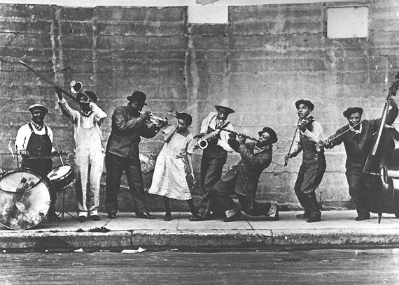 King Oliver's Creole Jazz Band - San Francisco 1921   Left to right: Ram Hall, Honore Dutrey, King Oliver, Lil Hardin-Armstrong, David Jones, Johnny Dodds, Jimmie Palao, Ed Garland