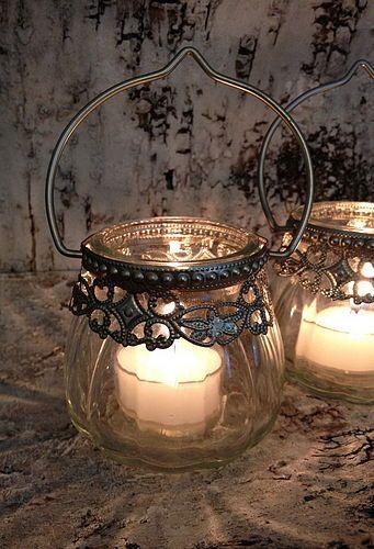 Silver vintage lanterns--Hmm...I saw some fish bowl style vases at Dollar Tree that might make nice lanterns.