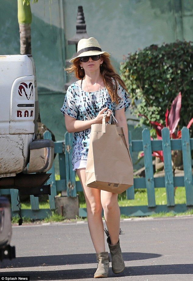 3-1-2014,Fun in the sun: The redhead is currently on holiday with her husband Sacha Baron Cohen and her two daughters - Olive and Elula