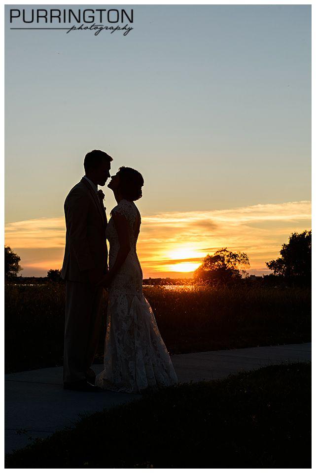 Sunset silhouette of bride and groom.  Fun creative idea for wedding photos.  © Purrington Photography Bemidji Wedding Photographer