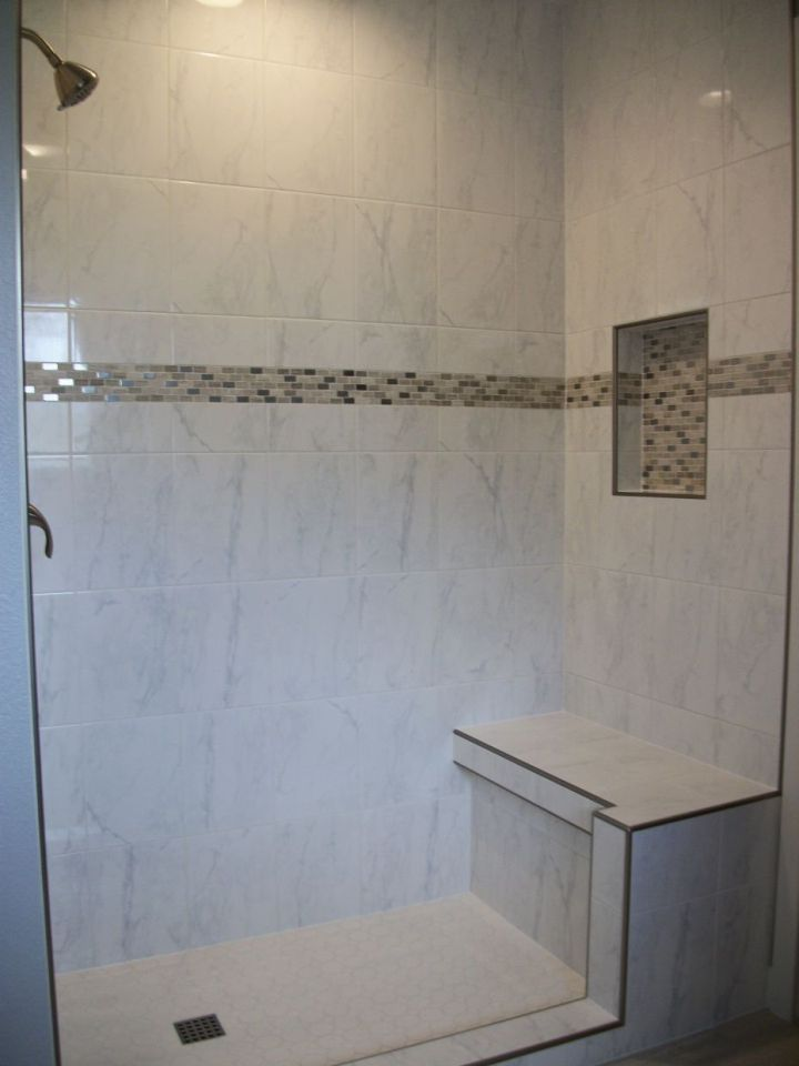 White Ceramic Tile Shower With Accent Band And Nickel