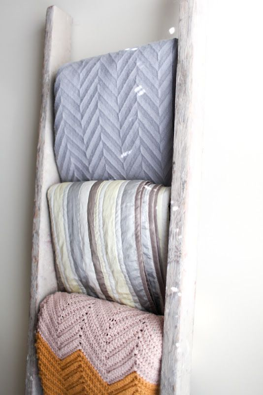 Repurposed ladder to hold towels and blankets for guests