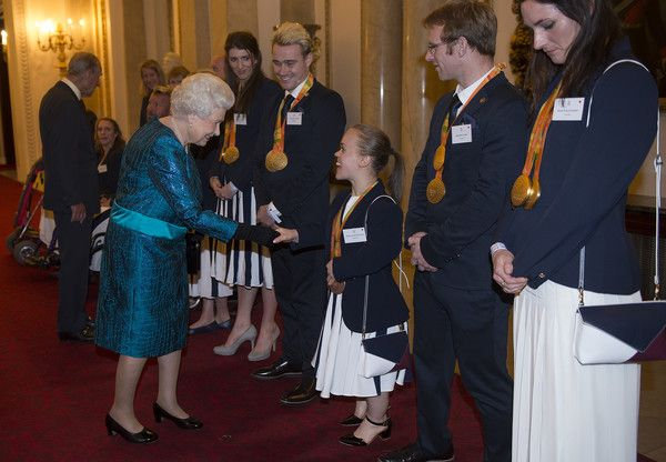 Queen Elizabeth II Photos Photos - Queen Elizabeth II speaks with paralympians Ellie Simmonds, Jody Cundy and Sarah Storey at a reception for Team GB's 2016 Olympic and Paralympic teams at Buckingham Palace October 18, 2016 in London, England. - Olympics & Paralympics Team GB - Rio 2016 Victory Parade