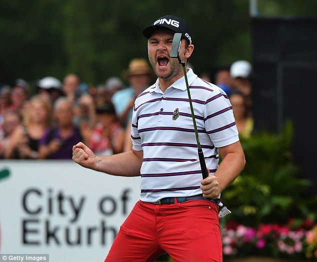 Andy Sullivan celebrates on the 18th hole after his winning putt in the sudden-death play-off