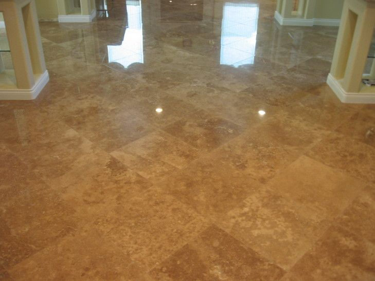 18 iINCH POLISHED NOCE TRAVERTINE ON A DIAGONAL. ONCE AGAIN NOTICE THE EVEN DISTRIBUTION OF LIGHT AND DARK TILES. AND ONCE AGAIN WE NAILED THE GROUT COLOR. WE DO GROUT SAMPLES BEFORE GROUTING THE WHOLE TILE INSTALLATION. SO NO SURPRISES.
