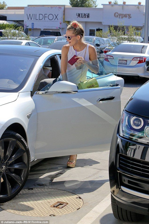 Where to next?The rumoured girlfriend of Dancing With The Stars' Derek Hough jumped into the driver's seat of her Tesla car