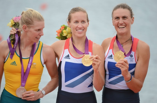 Gold medalists (L-R) Helen Glover and Heather Stanning of Great Britain pose with silver medalist Sarah Tait of Australia after competing in the Women's Pair Final