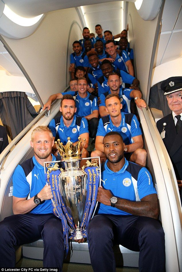 Schmeichel (left) and his Leicester team-mates were all smiles on Sunday as they flew to LA for pre-season